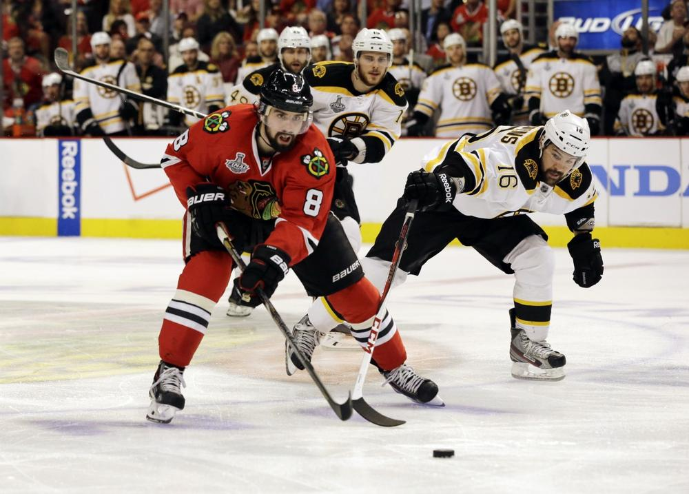 The Chicago Blackhawks took Game 1 of the Stanley Cup Finals in triple overtime, but the Boston Bruins have come from behind in big series before. (Nam Y. Huh/AP)