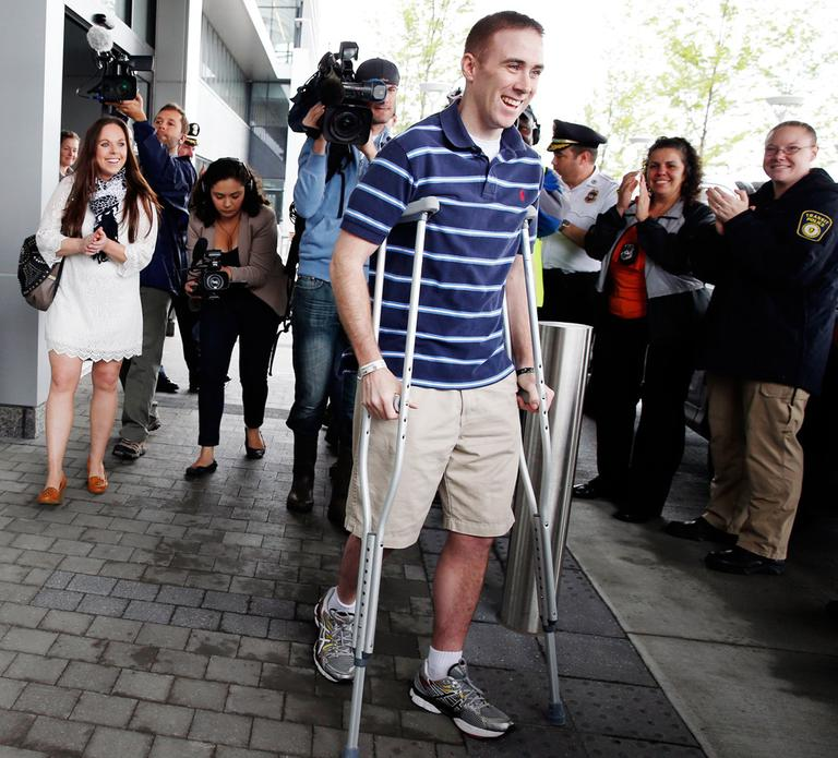 Transit Police Officer Richard Donohue, center, as he left Spaulding Rehabilitation Hospital in Boston last month (Michael Dwyer/AP)
