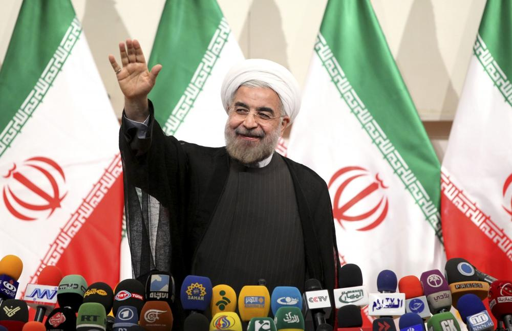 Iranian President-elect Hasan Rowhani waves to media at the start of a press conference in Tehran, Iran, Monday, June 17, 2013. (Ebrahim Noroozi/AP)
