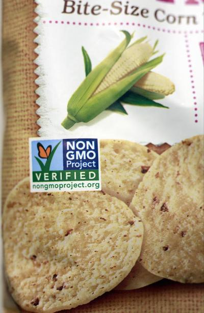 Some foods found in grocery stores advertise that they are made without GMOs. But there are no laws currently in effect in the U.S. that require products with GMOs to be labeled as such. (Damien Dovaganes/AP)