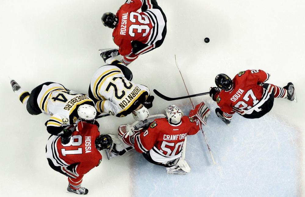 Chicago Blackhawks goalie Corey Crawford (50) blocks a shot against the Boston Bruins in the second period during Game 5 of the NHL hockey Stanley Cup Finals, Saturday, June 22, 2013, in Chicago. The Blackhawks won 3-1. (Nam Y. Huh/AP)