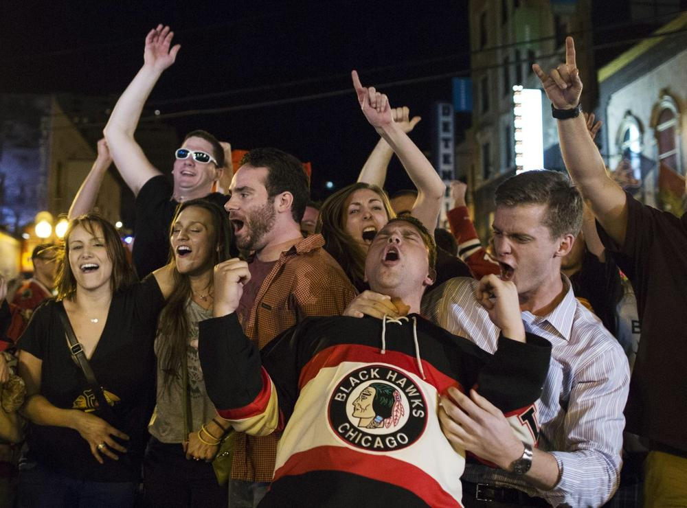 Chicago fans celebrate after the Blackhawks win the Stanley Cup. (Scott Eisen/AP)
