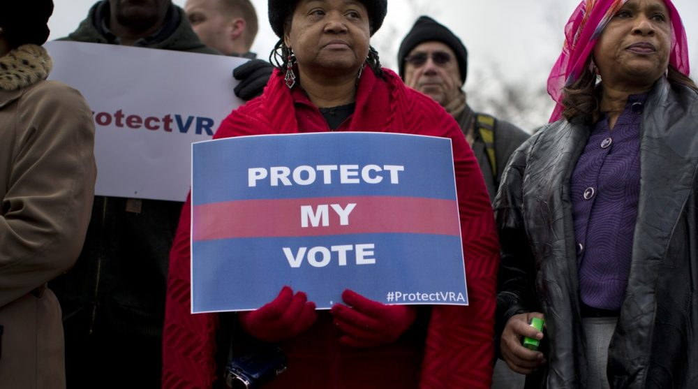 People wait in line outside the Supreme Court in Washington, Wednesday, Feb. 27, 2013, to listen to oral arguments in the Shelby County, Ala., v. Holder voting rights case. The Supremec Court is expected to release its decision in the coming weeks. (Evan Vucci/AP)