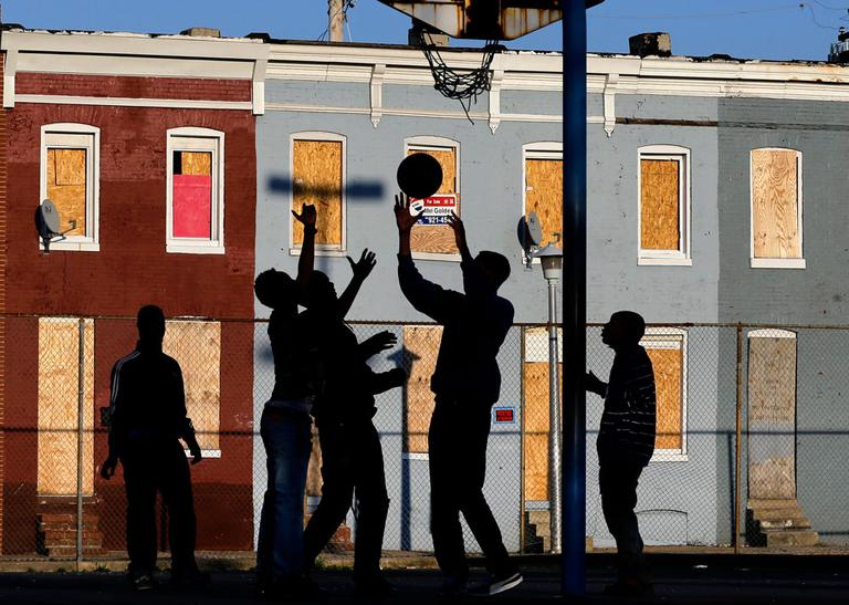 Children play basketball at a park in Baltimore. (Patrick Semansky/AP)