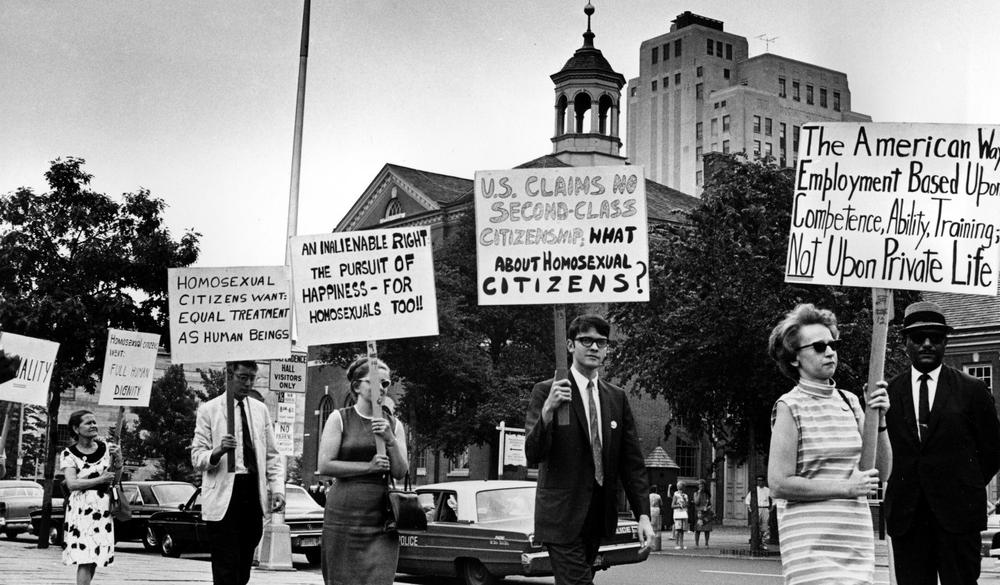 In this July 4, 1967 photo, Kay Tobin Lahusen, right, and other demonstrators carry signs calling for protection of homosexuals from discrimination as they march in a picket line in front of Independence Hall in Philadelphia. (AP)