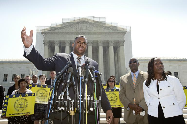 Ryan P. Haygood, director of the NAACP Legal Defense Fund, talks outside the Supreme Court in Washington, Tuesday, June 25, 2013, about the Shelby County v. Holder. The Supreme Court says a key provision of the landmark Voting Rights Act cannot be enforced until Congress comes up with a new way of determining which states and localities require close federal monitoring of elections. (J. Scott Applewhite/AP)