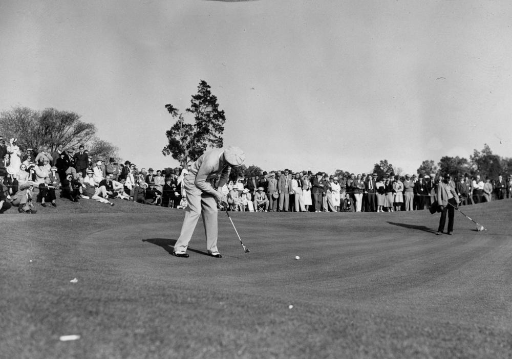 Byron Nelson of Reading, Pa., putts on the 18th green at the Augusta National Invitational at the Augusta National Golf Club in Augusta, Ga., April 2, 1937. (AP)