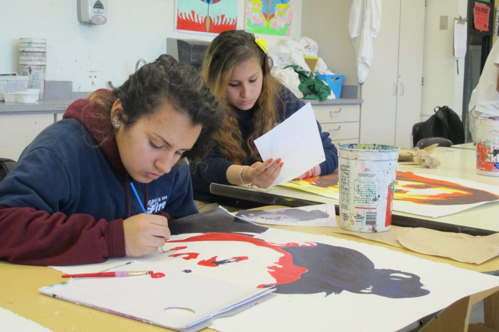 Students paint at the Orchard Gardens School. (Ava Aguado/WBUR)