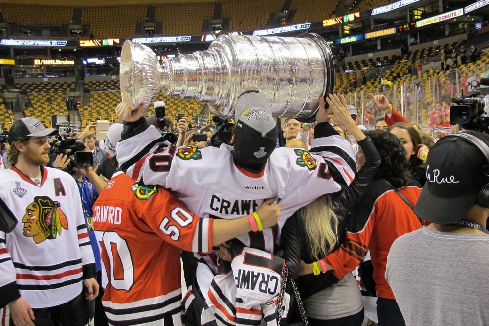 Chicago goalie Corey Crawford (holding cup) celebrates the Blackhawks' victory over the Boston Bruins Monday night at TD Garden in Boston. (Doug Tribou/Only A Game)