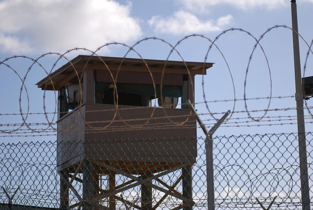 GUANTANAMO BAY, Cuba (Dec. 31, 2009) A Soldier stands guard in a tower at Camp Delta at Joint Task Force Guantanamo Bay. (U.S. Army photo by Spc. Cody Black/Wikimedia Commons)