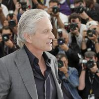 Actor Michael Douglas poses for photographers during a photo call for the film Behind the Candelabra at the 66th international film festival, in Cannes, southern France, Tuesday, May 21, 2013. (AP Photo/Francois Mori)