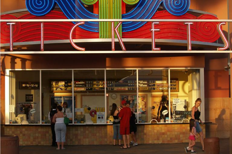 People buy their tickets at a movie theater in Cathedral City, Calif. (Raymond Shobe/Flickr, CC BY-SA 2.0)