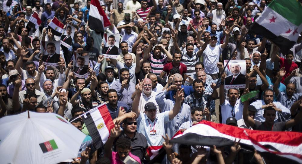Supporters of Egypt's Islamist President Mohammed Morsi rally near Cairo University in Giza, Egypt, Tuesday, July 2, 2013. (Manu Brabo/AP)