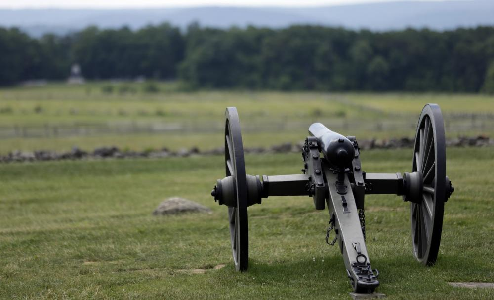 A Union artillery piece sits atop a ridge above the field of Pickett's Charge, Wednesday, June 5, 2013, in Gettysburg, Pa. (Matt Rourke/AP)