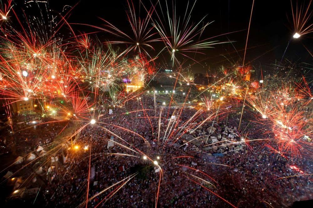 Fireworks light the sky opponents of Egypt's Islamist President Mohammed Morsi celebrate in Tahrir Square in Cairo, Egypt, Wednesday, July 3, 2013. (Amr Nabil/AP)