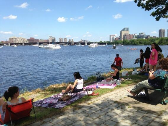 People enjoy the breeze on the Esplanade. (Lynn Jolicoeur/WBUR)