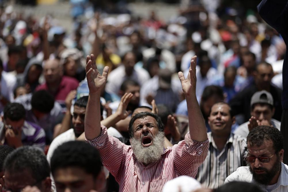 Supporters of ousted Egyptian President Mohammed Morsi pray during the Friday prayer before a protest near the University of Cairo, Giza, Egypt, Friday. (AP)