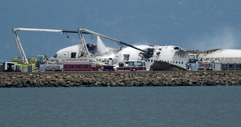 A fire truck sprays water on Asiana Flight 214 after it crashed at San Francisco International Airport on Saturday, July 6, 2013, in San Francisco. (Noah Berger/AP)