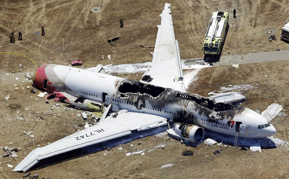 This aerial photo shows the wreckage of the Asiana Flight 214 airplane after it crashed at the San Francisco International Airport in San Francisco, Saturday, July 6, 2013. (Marcio Jose Sanchez/AP)