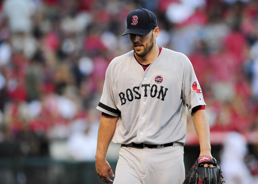 Boston Red Sox starting pitcher John Lackey reacts after getting himself out of trouble in the sixth inning of a baseball game against the Los Angeles Angels. (Gus Ruelas/AP)