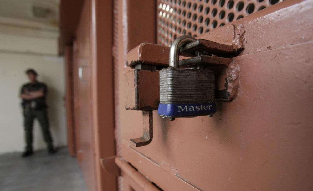 A lock is seen on a small port where items are passed to inmates without having to open the cell door in the Secure Housing Unit at the Pelican Bay State Prison near Crescent City, Calif., Wednesday, Aug. 17, 2011. (Rich Pedroncelli/AP)
