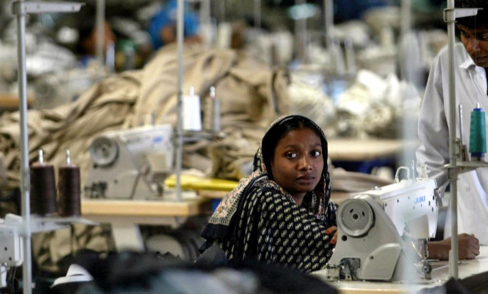 A Bangladeshi woman works in a textile factory on the outskirts of Dhaka, Bangladesh, Wednesday, Feb. 2, 2005. (Manish Swarup/AP)