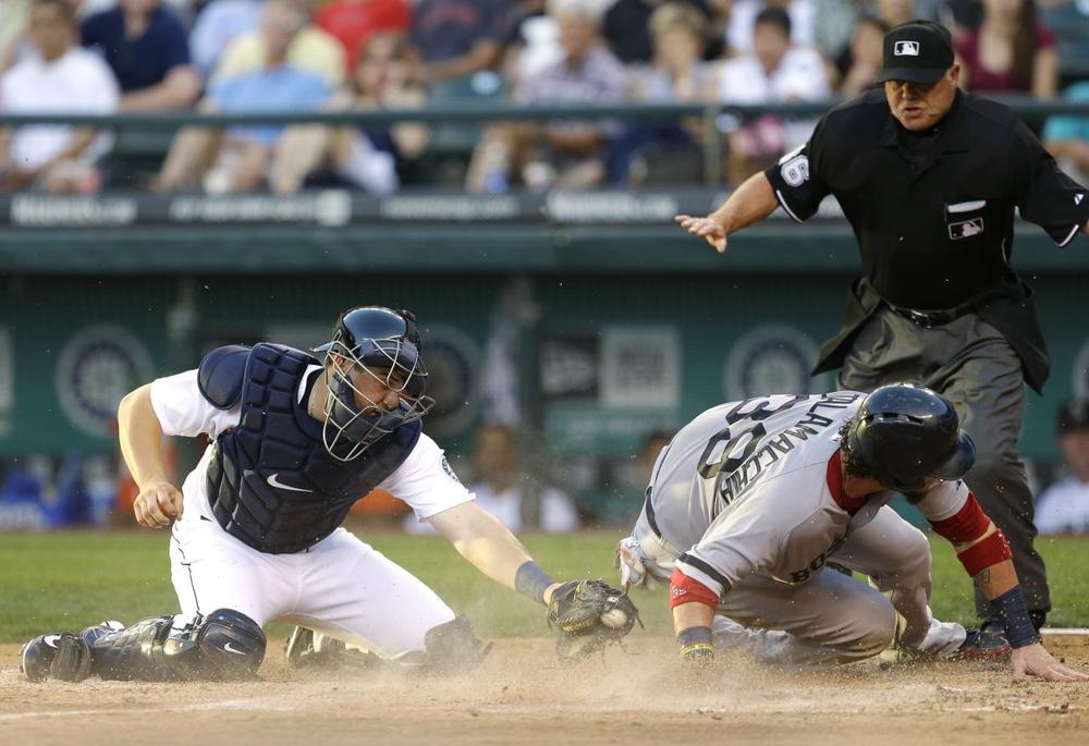 Red Sox's Jarrod Saltalamacchia, right, scores past the tag attempt of Seattle Mariners catcher Mike Zunino. (Ted S. Warren/AP)
