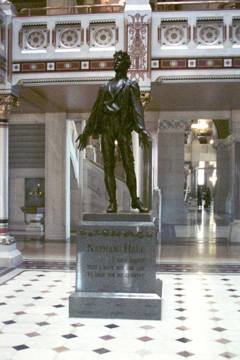 A statue of Revolutionary War hero and Connecticut native Nathan Hale is seen here at the state Capitol in Hartford. Hale was executed by the British when he was caught spying. (Bob Child/AP)
