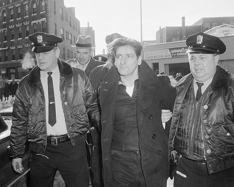 Albert DeSalvo, 35, is surrounded by police after his capture in Lynn on Feb. 25, 1967. DeSalvo was nabbed in a store a day after he escaped from Bridgewater State Hospital for the criminally insane. (AP)