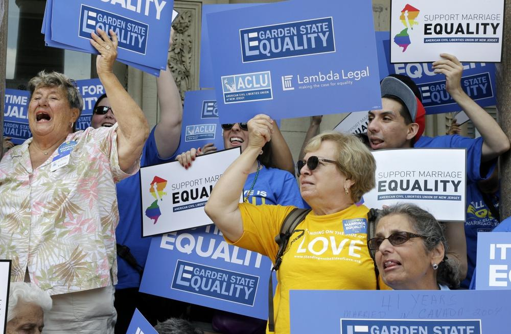 Advocates for gay marriage in New Jersey gather outside the Statehouse in Trenton, N.J., June 27, 2013. (Mel Evans/AP)
