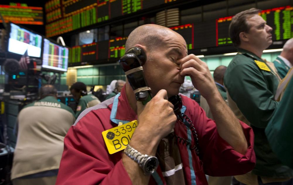 A trader works in the oil options pit at the New York Mercantile Exchange, Wednesday, July 3, 2013. (Richard Drew/AP)