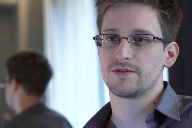 "This photo provided by The Guardian Newspaper in London shows Edward Snowden, who worked as a contract employee at the National Security Agency, on Sunday, June 9, 2013, in Hong Kong. The ""NSA leaker"" claims the spy agency gathers all communications into and out of the U.S. for analysis, despite government claims that it only targets foreign traffic. (Glenn Greenwald and Laura Poitras, The Guardian/AP)"