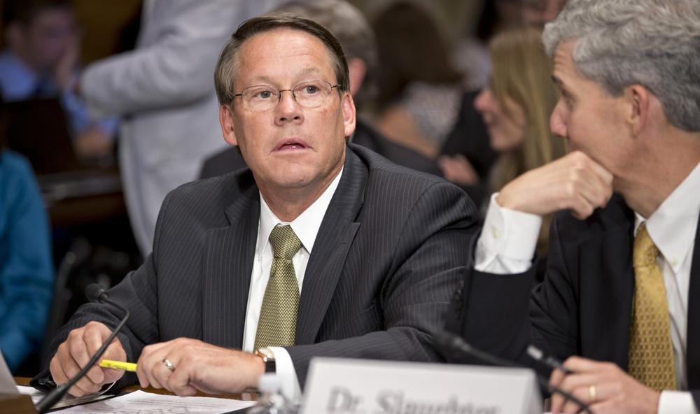 Smithfield Foods CEO Larry Pope takes his seat on Capitol Hill in Washington, Wednesday, July 10, 2013, before the start of a Senate Agriculture Committee hearing on the pending sale of Smithfield to China's largest meat producer. (J. Scott Applewhite/AP)