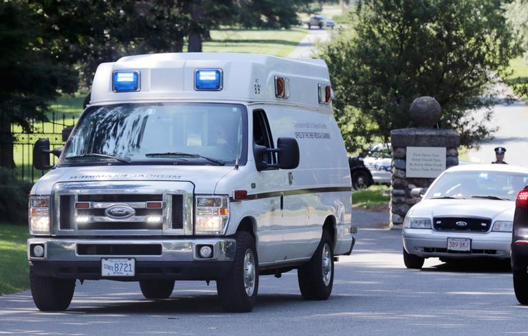A medical examiner's van leaves the Puritan Lawn Memorial Park in Peabody Friday after exhuming Albert DeSalvo's body from a grave to confirm a DNA link to a Boston Strangler case. (Charles Krupa/AP)