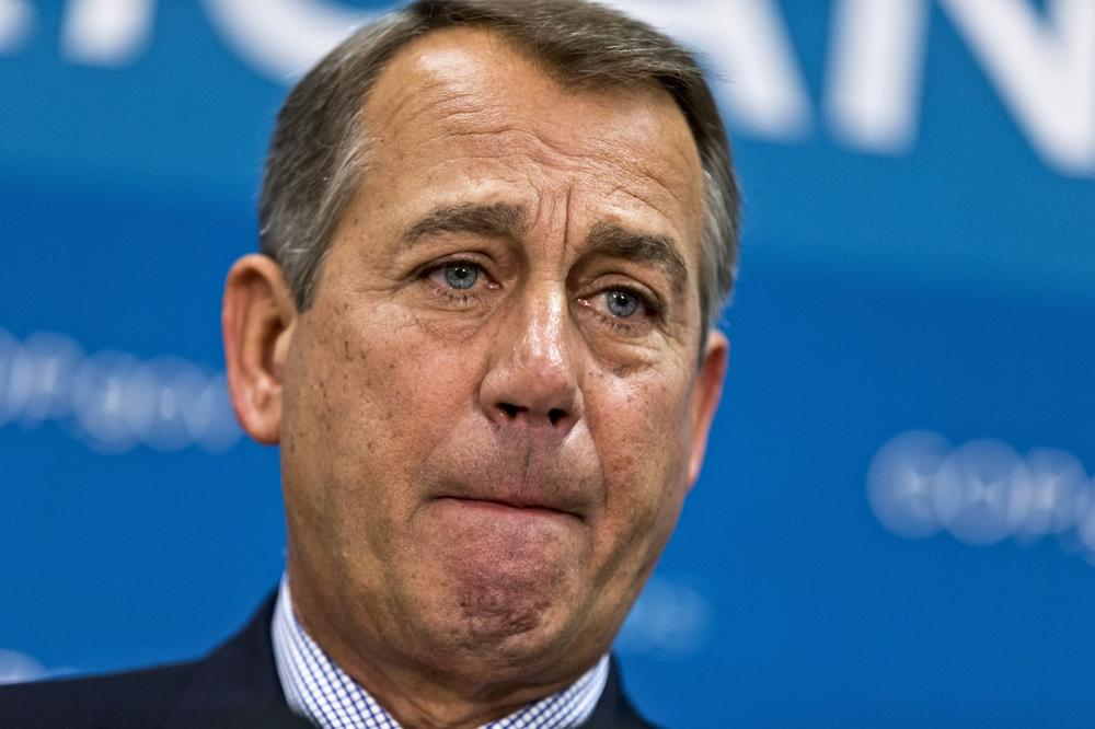 House Speaker John Boehner of Ohio, and GOP leaders, pauses while meeting with reporters on Capitol Hill in Washington, Tuesday, July 9, 2013, following a Republican strategy session. (J. Scott Applewhite/AP)