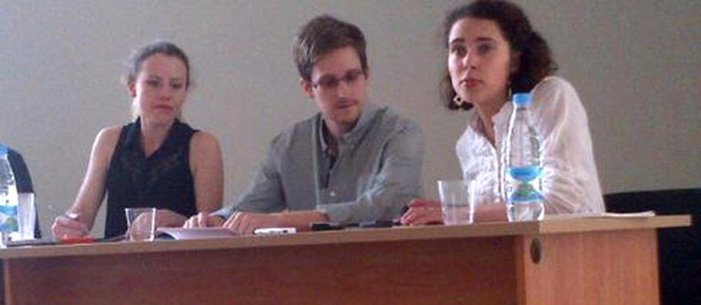 Edward Snowden attended a news conference at Moscow's Sheremetyevo Airport with Sarah Harrison of WikiLeaks, left, pm Friday. Reports say Snowden wants to seek temporary asylum in Russia (Tanya Lokshina/Human Rights Watch, )