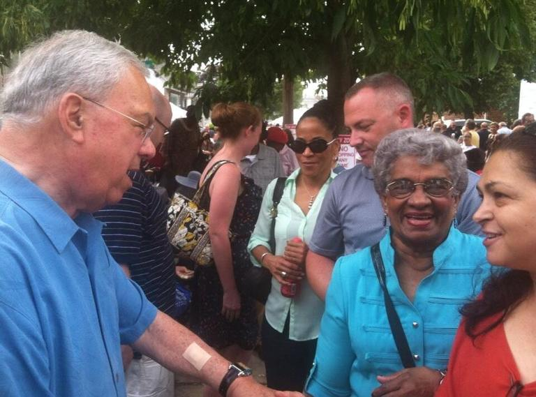 Mayor Menino greets supporters at his 20th block party. (Fred Thys/WBUR)
