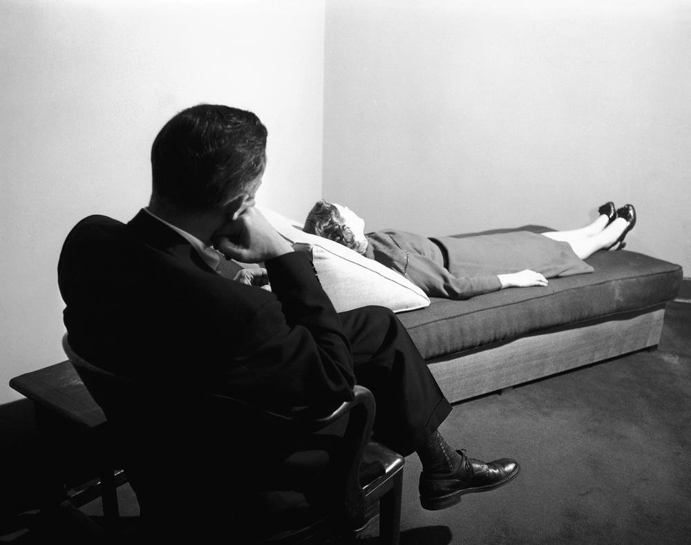A psychoanalyst listens to a patient digging into her past at the New York Psychoanalytic Institute Treatment Center in New York, April 25, 1956. (Bob Wands/AP)