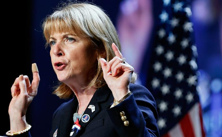 Attorney General Martha Coakley speaks at the state Democratic Convention in Lowell Saturday. (Michael Dwyer/AP)