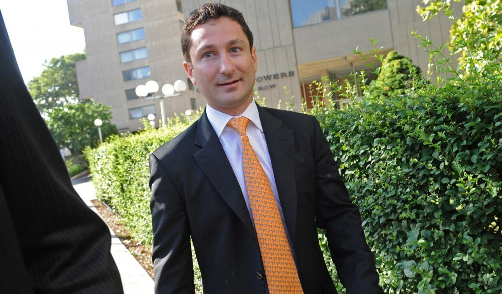 Former Goldman Sachs Group Inc. executive Fabrice Tourre enters Manhattan federal court on the first day of his trial, Monday, July 15, 2013, in New York. (Louis Lanzano/AP)