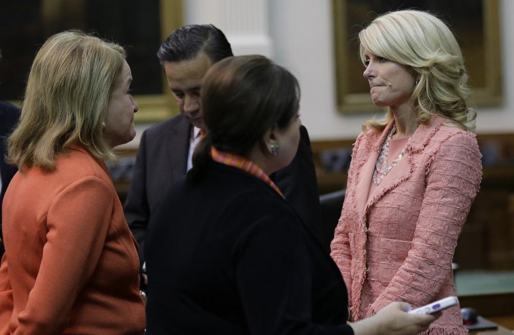 Sen. Wendy Davis, D-FortWorth, right, stands with fellow senators as Texas Senate debates abortion bill HB2, Friday, July 12, 2013, in Austin, Texas. (Eric Gay/AP)
