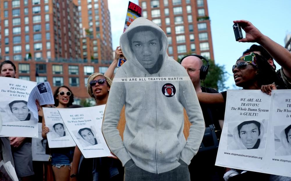 Activists on Union Square stand with a cut out photo of Trayvon Martin, Sunday, July 14, 2013, in New York, during a protest against the acquittal of volunteer neighborhood watch member George Zimmerman in the 2012 killing of 17-year-old Trayvon Martin in Sanford, Fla. (Craig Ruttle/AP)