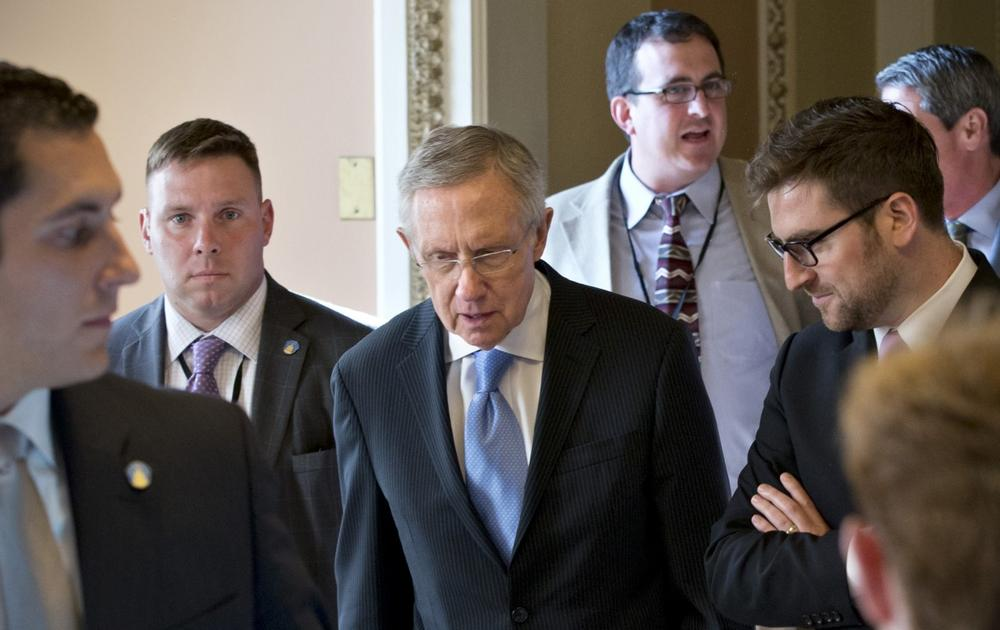 Senate Majority Leader Harry Reid, D-Nev., center, walks to closed-door meeting in the Old Senate Chamber for a showdown over presidential nominees that have been blocked by a GOP filibuster, at the Capitol in Washington, Monday, July 15, 2013. (J. Scott Applewhite/AP)