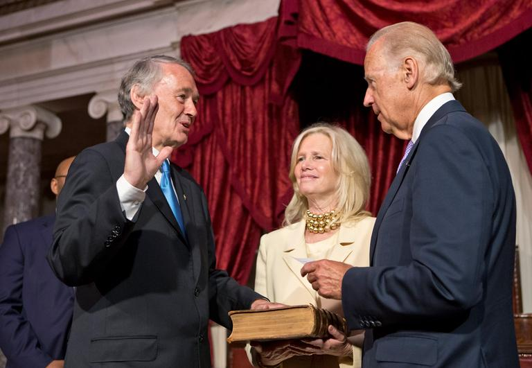 Sen. Edward Markey raises his hand to repeat the oath for Vice President Joe Biden in the Old Senate Chamber Tuesday, following his official ceremony earlier in the Senate Chamber. He is joined by his wife, Dr. Susan J. Blumenthal, center. (J. Scott Applewhite/AP)