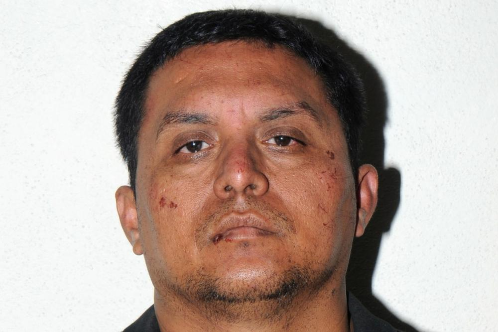 In this photo released on Tuesday, July 16, 2013 by the Mexican Navy, is Zetas drug cartel leader Miguel Angel Trevino Morales after his arrest in Mexico. (Mexican Navy via AP)
