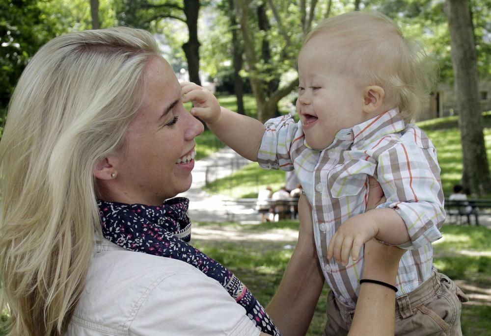 Erin Witkowski, of Port Jervis, N.Y., and her 16-month-old son Grady pose for photos in New York's Central Park, June 6, 2011. (Richard Drew/AP)