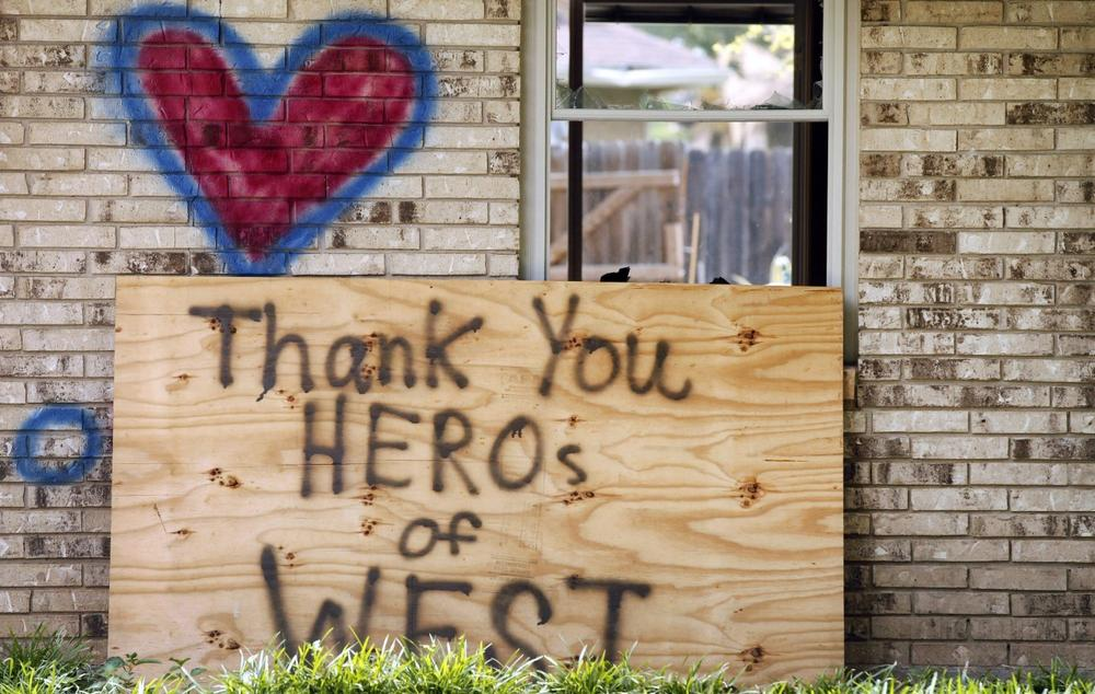 A home spray painted with a heart and an inspirational message, damaged by the fertilizer plant explosion along Reagan Street is shown Friday, May 31, 2013, in West, Texas. (Tony Gutierrez/AP)