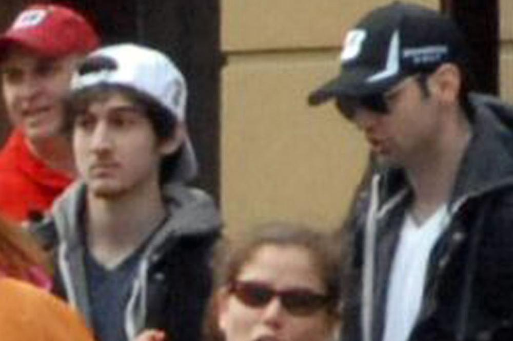 Dzhokhar and Tamerlan Tsarnaev pictured moments before the blasts that struck the Boston Marathon, April 15, 2013. (Bob Leonard/AP)