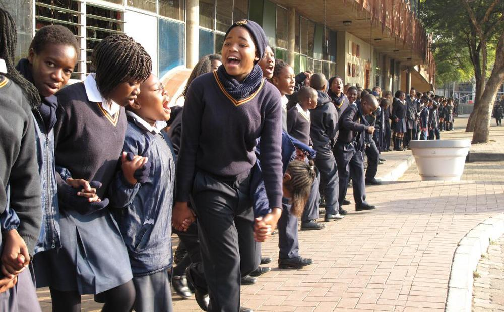 "Children sing to Nelson Mandela on his 95th birthday in Johannesburg, South Africa. (<a href=""https://twitter.com/jasonbnpr/status/357794978925268992"" target=""_blank"">Jason Beaubien/Twitter</a>)"
