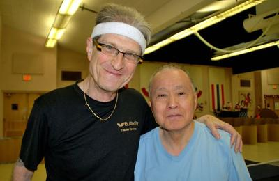 Carlo Wolff and Fumio Yoshikawa during a break in the table tennis action. (WCPN)
